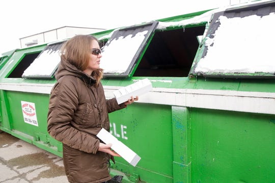 Amy Krzton-Presson holds a pair of cardboard boxes that were found in black trash bags in the incorrect sorting bin, Thursday, Feb. 27, 2020 at the Tippecanoe County Solid Waste District in Lafayette.