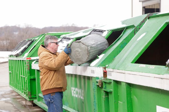 John Satterly of West Lafayette carries his recycling to a sorting bin, Thursday, Feb. 27, 2020 at the Tippecanoe County Solid Waste District in Lafayette.