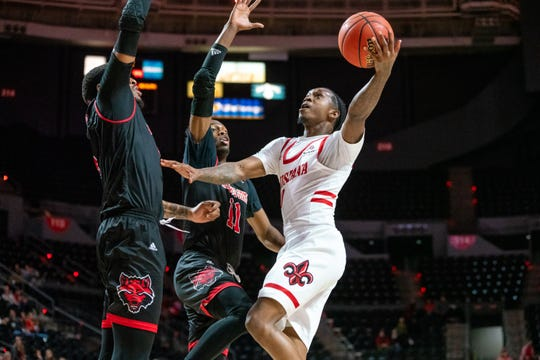 Cedric Russell takes the ball to the basket during UL's Feb. 26 win over Arkansas State. The same two teams meet Saturday in the Sun Belt Conference Tournament.