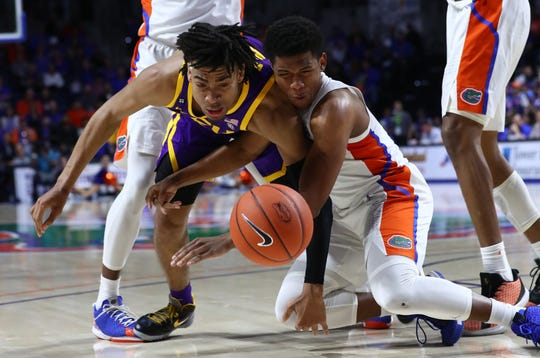 Feb 26, 2020; Gainesville, Florida, USA; LSU Tigers forward Trendon Watford (2) and Florida Gators guard Noah Locke (10) go after the rebound during the first half at Exactech Arena. Mandatory Credit: Kim Klement-USA TODAY Sports