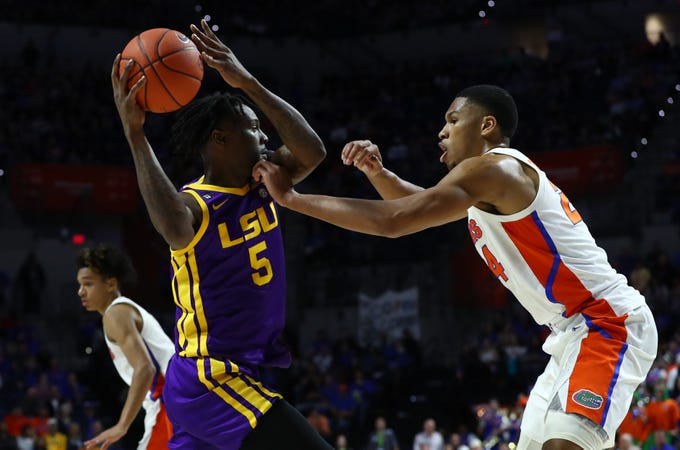Feb 26, 2020; Gainesville, Florida, USA; LSU Tigers forward Emmitt Williams (5) drives to the basket as Florida Gators forward Kerry Blackshear Jr. (24) defends during the first half at Exactech Arena. Mandatory Credit: Kim Klement-USA TODAY Sports