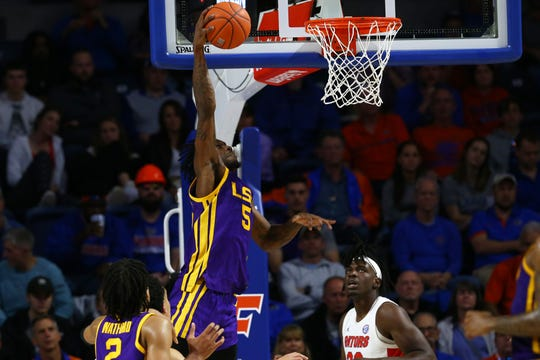 Feb 26, 2020; Gainesville, Florida, USA;LSU Tigers forward Emmitt Williams (5) dunks against the Florida Gators  during the second half at Exactech Arena. Mandatory Credit: Kim Klement-USA TODAY Sports