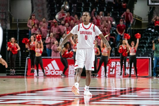 UL's Cedric Russell celebrates a big basket after Wednesday night's 77-74 win over Arkansas State at the Cajundome.