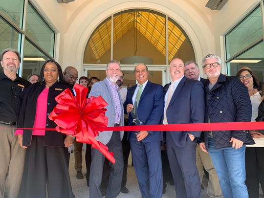 Officials with One Acadiana officially open Lafayette's all-new Ashley HomeStore at 200 Westmark Boulevard in retail space previously occupied by Olinde's Furniture.