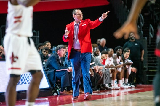 UL's Bob Marlin, shown here coaching against Arkansas State in February at the Cajundome, hopes scheduling is headed in more of a regional direction going forward.