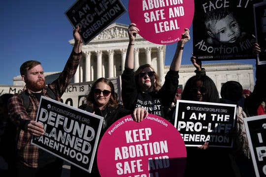 Protesters on both sides of the abortion debate gathered in 2018 to mark the anniversary of the 1973 Supreme Court ruling that legalized abortion.