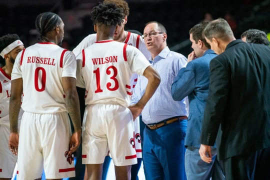 UL coach Bob Marlin talks to Mylik Wilson and the Ragin' Cajuns during a late-February win over Arkansas State at the Cajundome.
