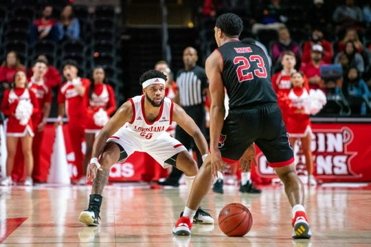 UL point guard Trajan Wesley, left, defends Arkansas State scoring leader Marquis Eaton when the two teams met in February at the Cajundome.