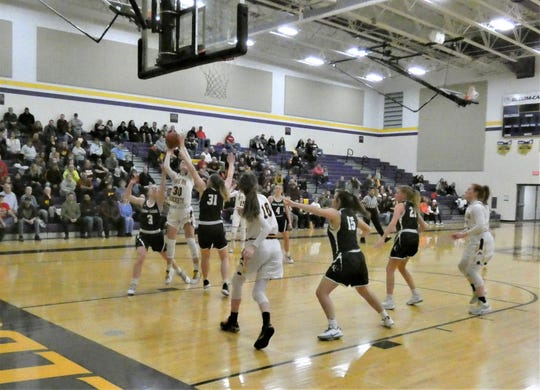 Berne Union's Bella Kline scores two of her game-high 19 points against Fisher Catholic during the Rockets' 50-23 Division IV district semifinal win Wednesday night.