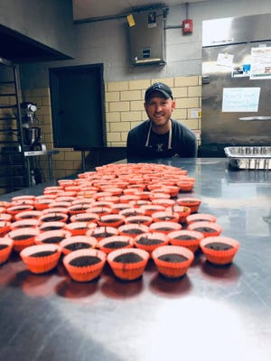 Whey Better Bakery co-owner Greg Hayes of Brighton makes peanut butter cups at Proud Mitten Shared Kitchen in Plymouth, before the novel coronavirus hit Michigan. He and his wife Keri's peanut butter cups will be featured on Home Shopping Network.