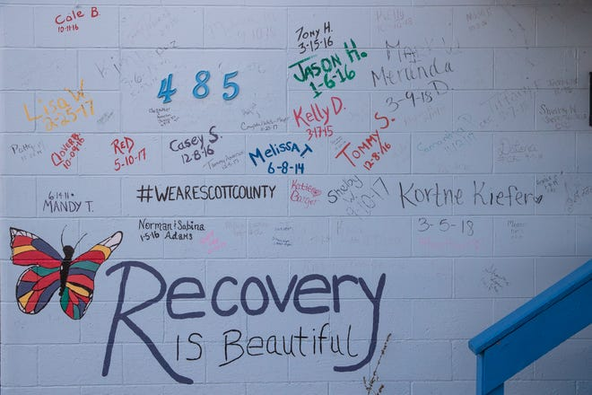 A wall on the Hope to the Others Church is dedicated to those in Austin, Ind., who have recovered from their opioid addiction. Photo taken on Thursday, Feb. 27, 2020.