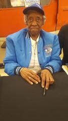 Alma Bailey in her blue Tuskegee Airmen Bomber Jacket