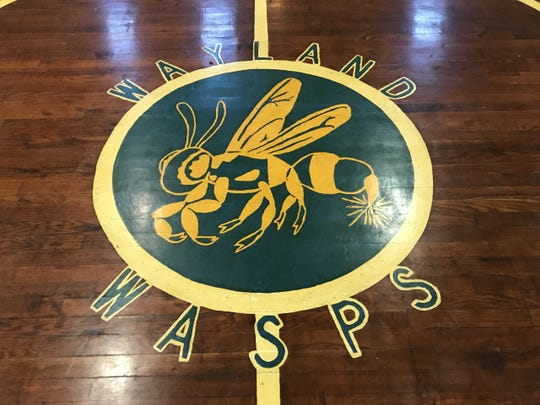The Wayland Wasps logo at center court of the old Wayland High School gymnasium.