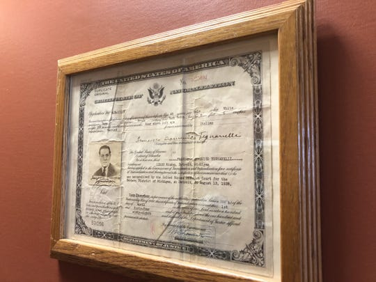 Citizenship papers Frank Tignanelli's grandfather Francesco Tignanelli obtained when he immigrated from Italy to the U.S. in the 1940s hang on the wall of his new Delta Township restaurant,  Detroit Frankie's Wood Fired Brick Oven.
