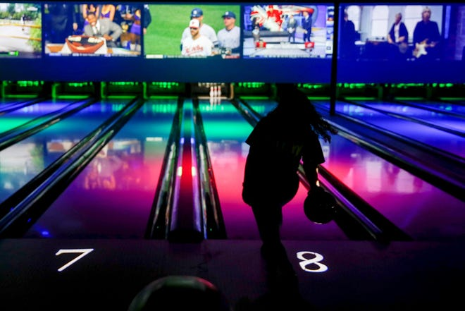 Cinergy employee trainer Hopey Martinez, of Amarillo, Texas, bowls during a tour of Cinergy Tulsa on Thursday, April 4, 2019. IAN MAULE/Tulsa World