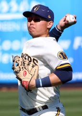Milwaukee Brewers Keston Hiura throws out a runner, during their spring training game against the Los Angeles Angels.