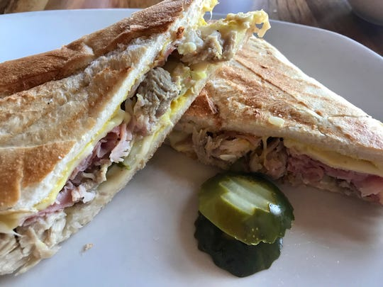 A medianoche sandwich, also known as a Cuban sandwich, is one of the lunchtime options at Aperitivo downtown.