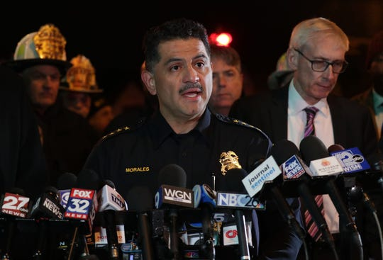 Milwaukee Police Chief Alfonso Morales addresses the media next to Wisconsin Gov. Tony Evers during a press conference near the scene of an active shooter situation on West State and North 35th streets near Molson Coors.