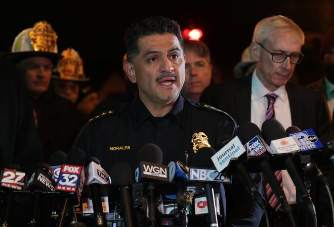 Milwaukee Police Chief Alfonso Morales addresses the media next to Wisconsin Gov. Tony Evers during a news conference near the scene of a mass shooting on West State and North 35th streets near the Molson Coors complex on Feb. 26.