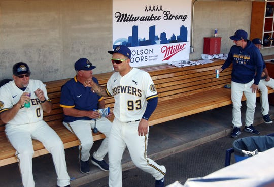 A Milwaukee Strong banner is displayed in the Brewers dugout,  in support of those affected by the Molson Coors shooting Wednesday.