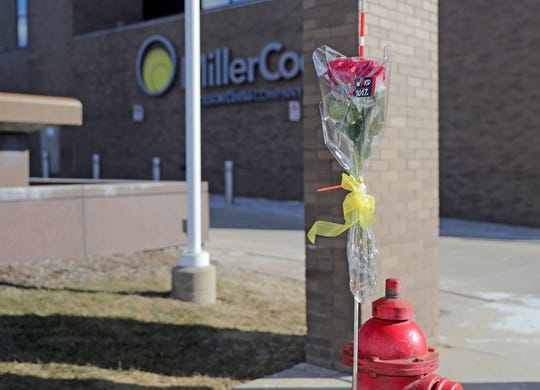 A bouquet of roses is taped to a fire hydrant outside the Molson Coors headquarters on West Highland Avenue in Milwaukee on Thursday.   In one of the worst shootings in Wisconsin history, a gunman killed five people — and then himself — during a rampage Wednesday afternoon on the Milwaukee campus of Molson Coors.
