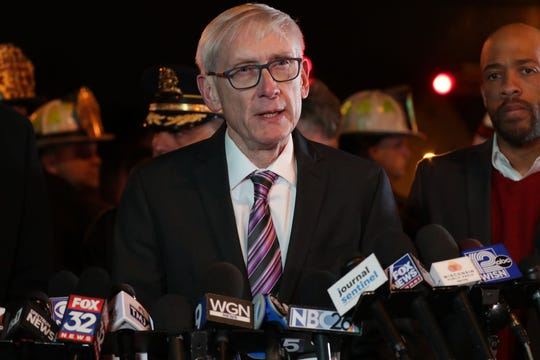 Wisconsin Gov. Tony Evers addresses the media during a press conference near Molson Coors in Milwaukee.
