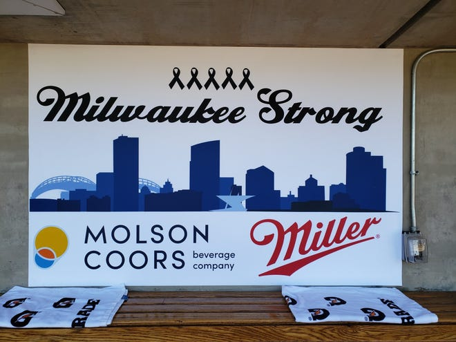 The Brewers hung this banner in their dugout Thursday in support of those affected by the Molson Coors shooting Feb. 26.