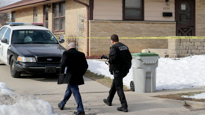 Investigators walk to a home believed to be that of the Molson Coors shooter in the 8200 block of West Potomac Avenue in Milwaukee on Thursday, Feb. 27, 2020.