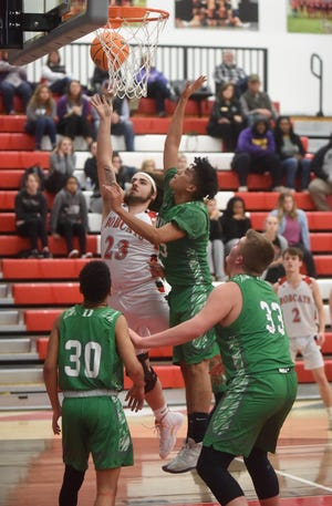 Flippin's Trevan Hudson goes up for two points against Danville's Javier Campos on Wednesday night at Eureka Springs.