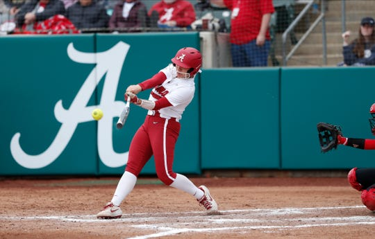 Alabama freshman catcher Abby Doerr connects on a pitch during a recent game against Louisville on Feb. 23, 2020 at Rhoads Stadium in Tuscaloosa.