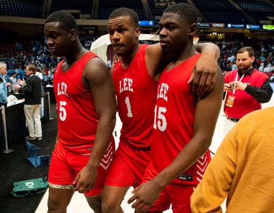 Lee's Deyunkrea Lewis (5) Jamari Smith (1) and De'Marquiese Miles (15) walk off the court after the game during the Class 7A boys semifinal at Legacy Arena in Birmingham, Ala., on Thursday, Feb. 27, 2020. Lee defeated Oak Mountain 65-57.