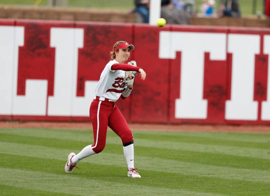 Alabama freshman center fielder Jenna Johnson (18) throws into the field during a recent game against Louisville on Feb. 23, 2020 at Rhoads Stadium in Tuscaloosa.