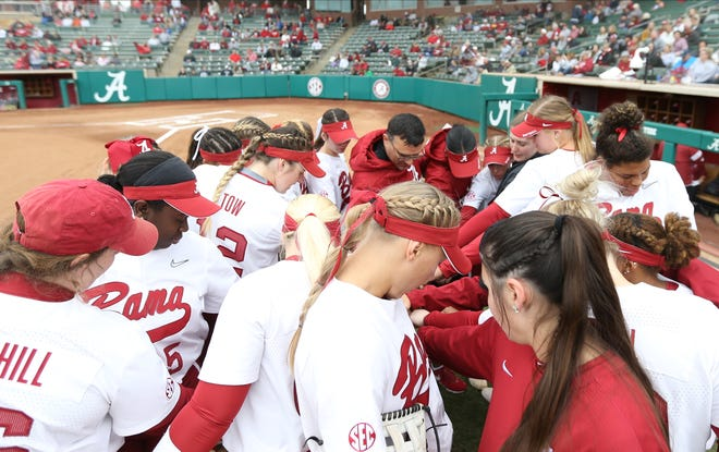 Alabama's softball team meets prior to a recent game against Louisville on Feb. 23, 2020 at Rhoads Stadium in Tuscaloosa.