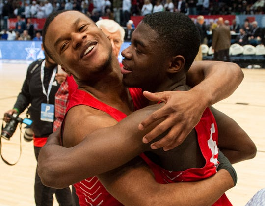 Lee's Jamari Smith (1) and Lee's De'Marquiese Miles (15) celebrate after the game during the Class 7A boys semifinal at Legacy Arena in Birmingham, Ala., on Thursday, Feb. 27, 2020. Lee defeated Oak Mountain 65-57.
