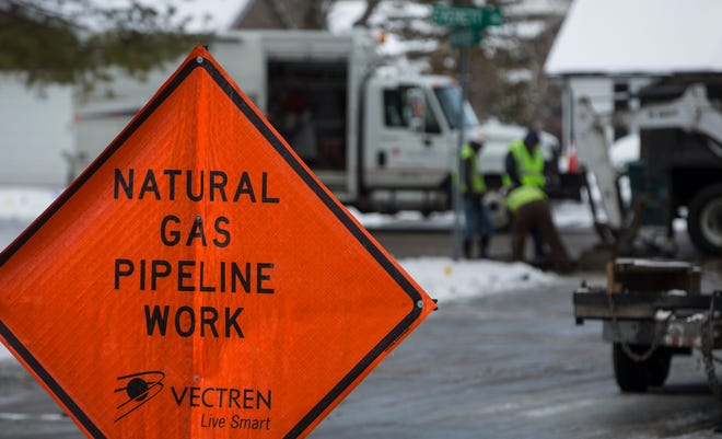 Utility crews work at the intersection of North Everett Road and West Woodbridge Drive to dig up a broken gas line. The road remained closed for a portion of the day and homes with natural gas were without heat until repairs were made.