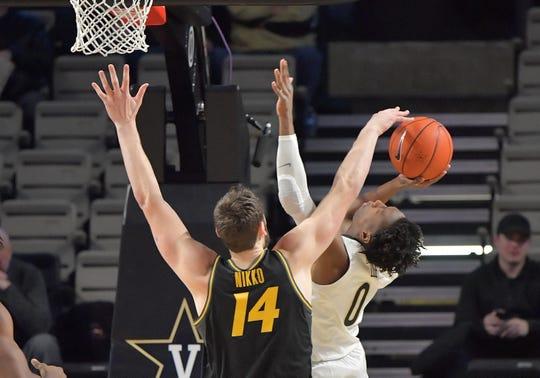 Missouri's Reed Nikko (14) blocks the shot by Vanderbilt guard Saben Lee (0) during the first half Wednesday at Memorial Gym.