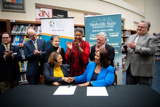 """Metro Nashville Public Schools interim director Adrienne Battle and President of Nashville State Community College Dr. Shanna Jackson shake hands after joining in the """"Better Together"""" partnership at Pearl-Cohn Entertainment Magnet High School Thursday, Feb. 27, 2020, in Nashville, Tenn."""