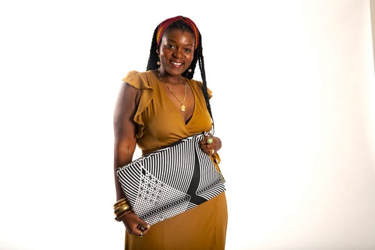 Keesha Morisma poses for a portrait with a computer bag she designed, Wednesday, Feb. 26, 2020, in Naples.