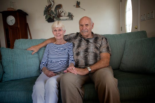 Ann DeVries and her husband Jack DeVries pose for a portrait, Thursday, Feb. 27, 2020, at their home in East Naples.