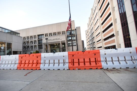 Barriers outside of Police headquarters. Due to recent threats against Paterson police and the chief himself, barriers are being placed in front of police headquarters