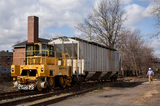 Stephen Guida from Strategic Rail Solutions walks along the tracks as the Atlas Trackmobile moves an abandoned rail car in Passaic on Thursday February 27, 2020.