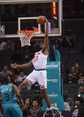 Feb 26, 2020; Charlotte, North Carolina, USA;  New York Knicks center Mitchell Robinson (23) dunks the ball in the closing seconds during the second half against the Charlotte Hornets at the Spectrum Center. Hornets win 107-101.