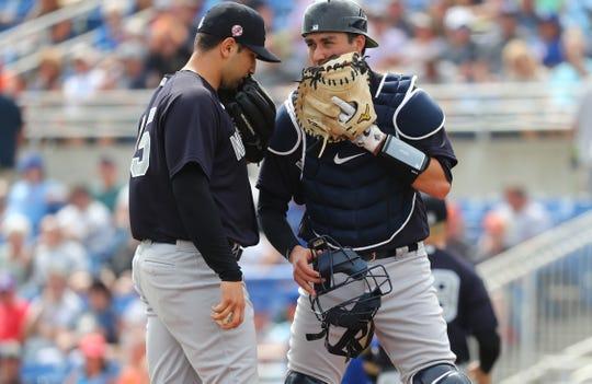 Feb 25, 2020; Dunedin, Florida, USA; New York Yankees relief pitcher Luis Cessa (85) talks with catcher Kyle Higashioka (66) on the mound during the third inning against the Toronto Blue Jays at TD Ballpark.