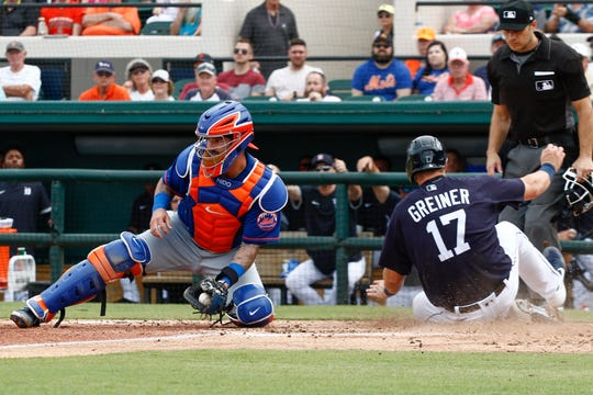 Feb 25, 2020; Lakeland, Florida, USA;   Detroit Tigers catcher Grayson Greiner (17) slides safely into home plate against New York Mets catcher Tomas Nido (3) during the  fifth inning at Publix Field at Joker Marchant Stadium.