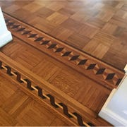 Restored and refinished, this parquet floor shows off the detailed inlay work that had to be recreated piece by piece.