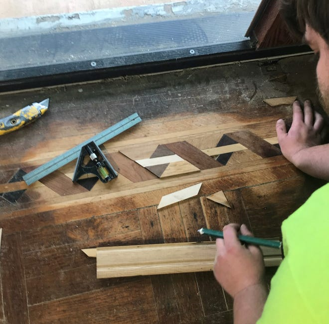 Recreating and replacing intricate inlay in a damaged vintage floor is detailed work, requiring the skills of a craftsman.