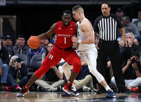 Rutgers Scarlet Knights forward Akwasi Yeboah (1) handles the ball as Penn State Nittany Lions forward John Harrar (21) defends during the first half at Bryce Jordan Center.
