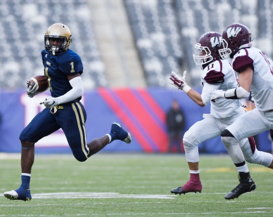 2015: North 1, Group 4 football state final between Wayne Hills vs Old Tappan at MetLife Stadium. (left) OT #1 Jordan Fuller runs with the ball in the fourth quarter.