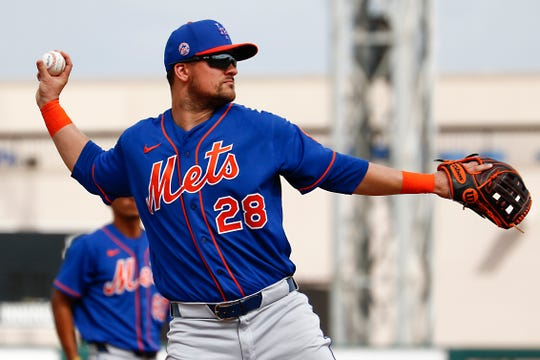 Feb 25, 2020; Lakeland, Florida, USA;   New York Mets third baseman J.D. Davis (28) throws to first for an out against the Detroit Tigers during the fifth inning at Publix Field at Joker Marchant Stadium.