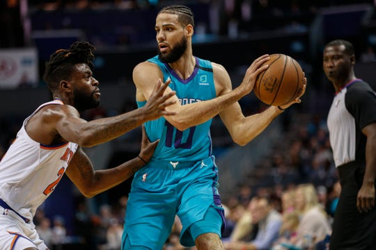 Charlotte Hornets forward Caleb Martin, right, keeps the ball from New York Knicks guard Reggie Bullock during the first half of an NBA basketball game in Charlotte, N.C., Wednesday, Feb. 26, 2020.